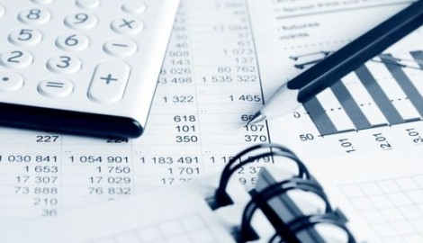 Calculator, pencil and stock index reports.